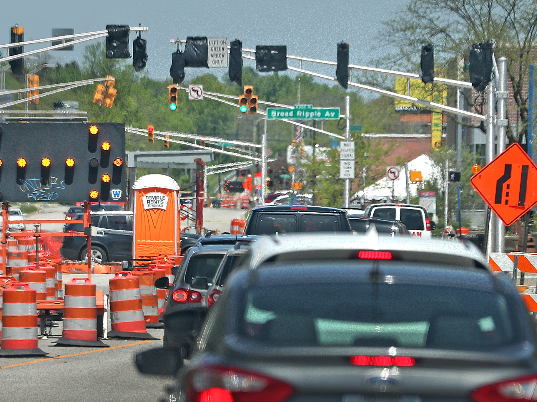 Cars move north past Red Line construction near Broad Ripple on College Ave., Sunday, May 5, 2019.  The City has updated the timeline when the Red Line Bus Rapid Transit system should open, which is later in 2019 summer.