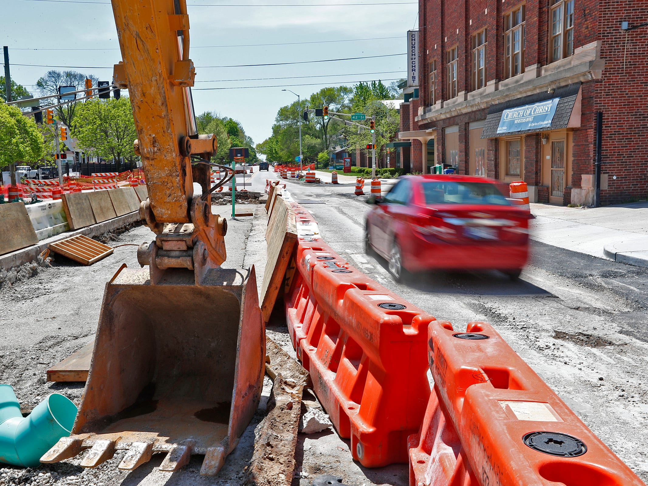 A car drives south towards 42nd St. on College Ave. by Red Line construction, Sunday, May 5, 2019.  The City has updated the timeline when the Red Line Bus Rapid Transit system should open, which is later in 2019 summer.