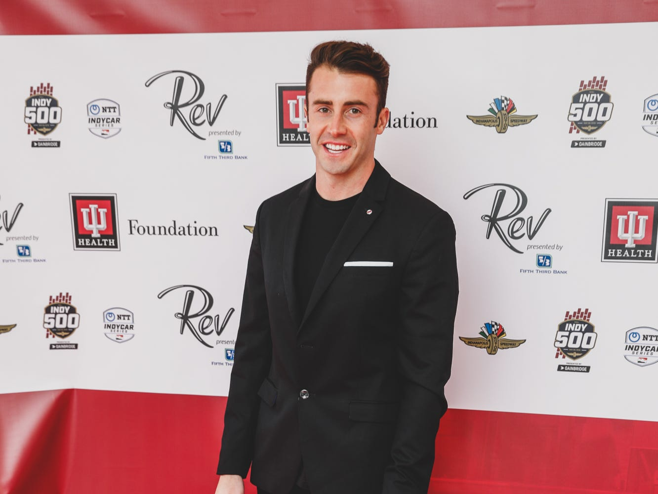 IndyCar driver James Davison walks the red carpet at the Rev Indy fundraiser, held at the Indianapolis Motor Speedway on Saturday, May 4, 2019. Funds raised support the IU Health Foundation statewide and the IU Health Emergency Medical Center at IMS.