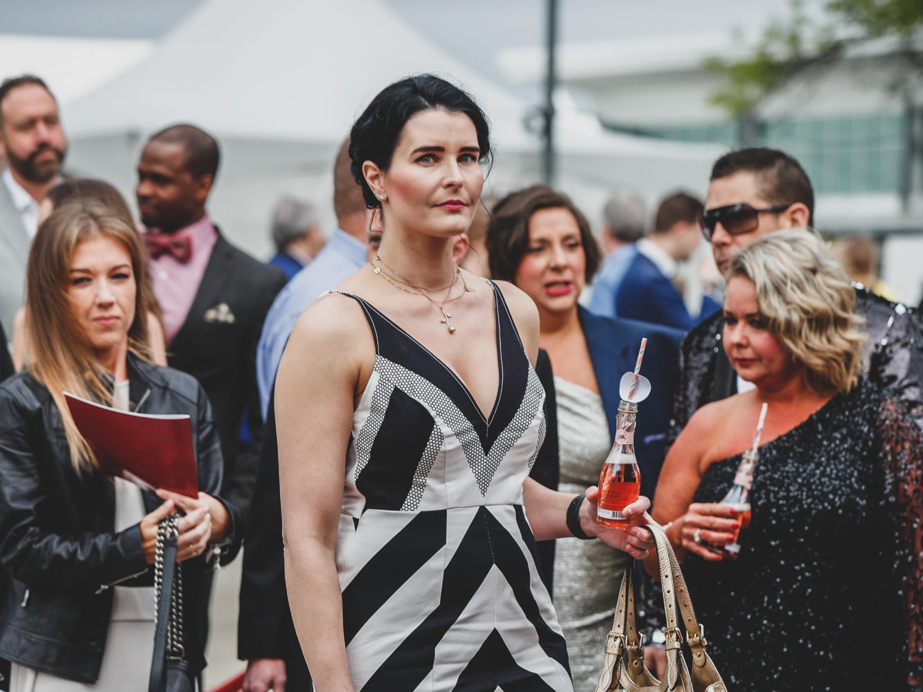 Guests wear their black and white best at the Rev Indy fundraiser held at the Indianapolis Motor Speedway on Saturday, May 4, 2019. Funds raised support the IU Health Foundation statewide and the IU Health Emergency Medical Center at IMS.