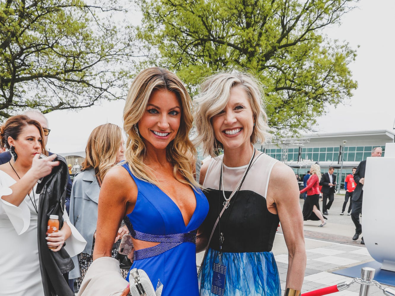Media Personality Mckenzie Roth, left, and  Molly Tittle walk the red carpet at the Rev Indy fundraiser, held at the Indianapolis Motor Speedway on Saturday, May 4, 2019. Funds raised support the IU Health Foundation statewide and the IU Health Emergency Medical Center at IMS.