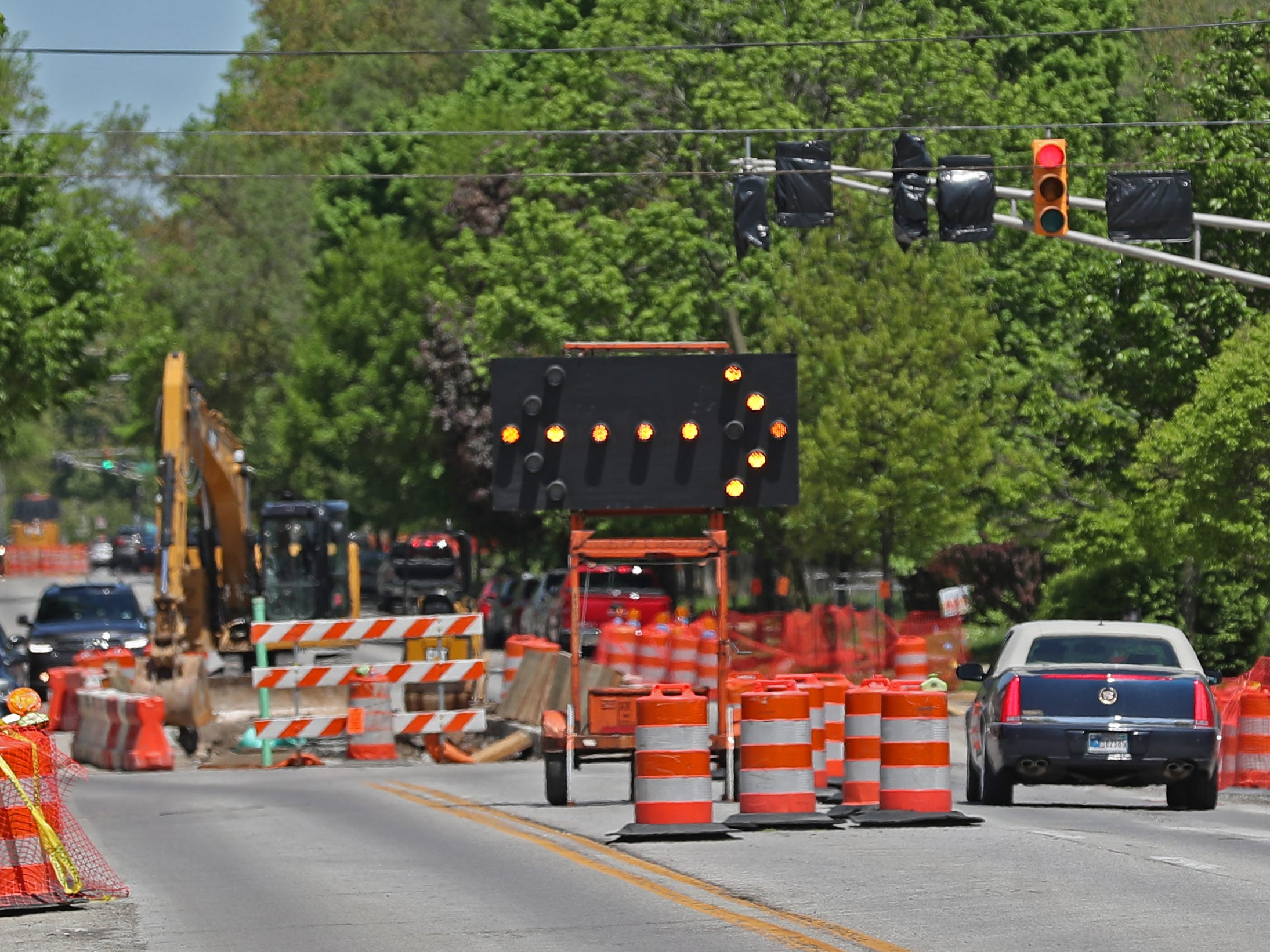 Cars move past Red Line construction on College Ave. near 42nd St., Sunday, May 5, 2019.  The City has updated the timeline when the Red Line Bus Rapid Transit system should open, which is later in 2019 summer.