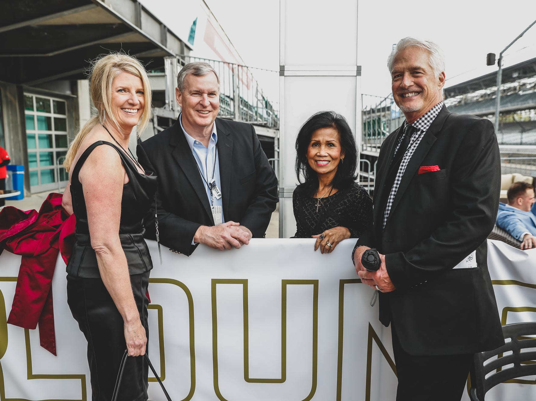Jlynn Cooper, left, Former Indianapolis Mayor Greg Ballard, center left, his wife Winnie Ballard, center right,  and Jeff Cooper attend the Rev Indy fundraiser, held at the Indianapolis Motor Speedway on Saturday, May 4, 2019. Funds raised support the IU Health Foundation statewide and the IU Health Emergency Medical Center at IMS.