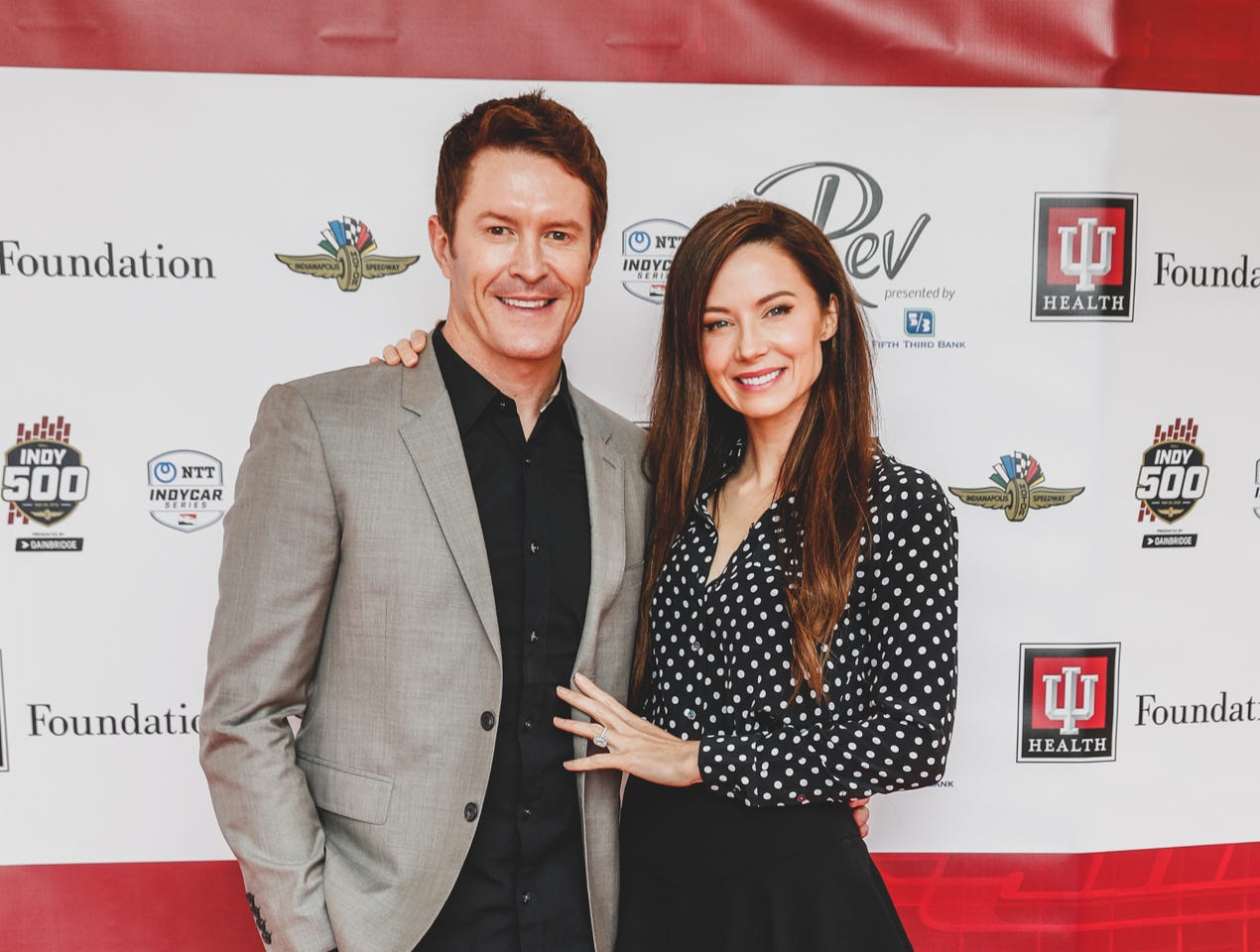 IndyCar driver Scott Dixon and his wife Emma Davies walk the red carpet at the Rev Indy fundraiser, held at the Indianapolis Motor Speedway on Saturday, May 4, 2019. Funds raised support the IU Health Foundation statewide and the IU Health Emergency Medical Center at IMS.