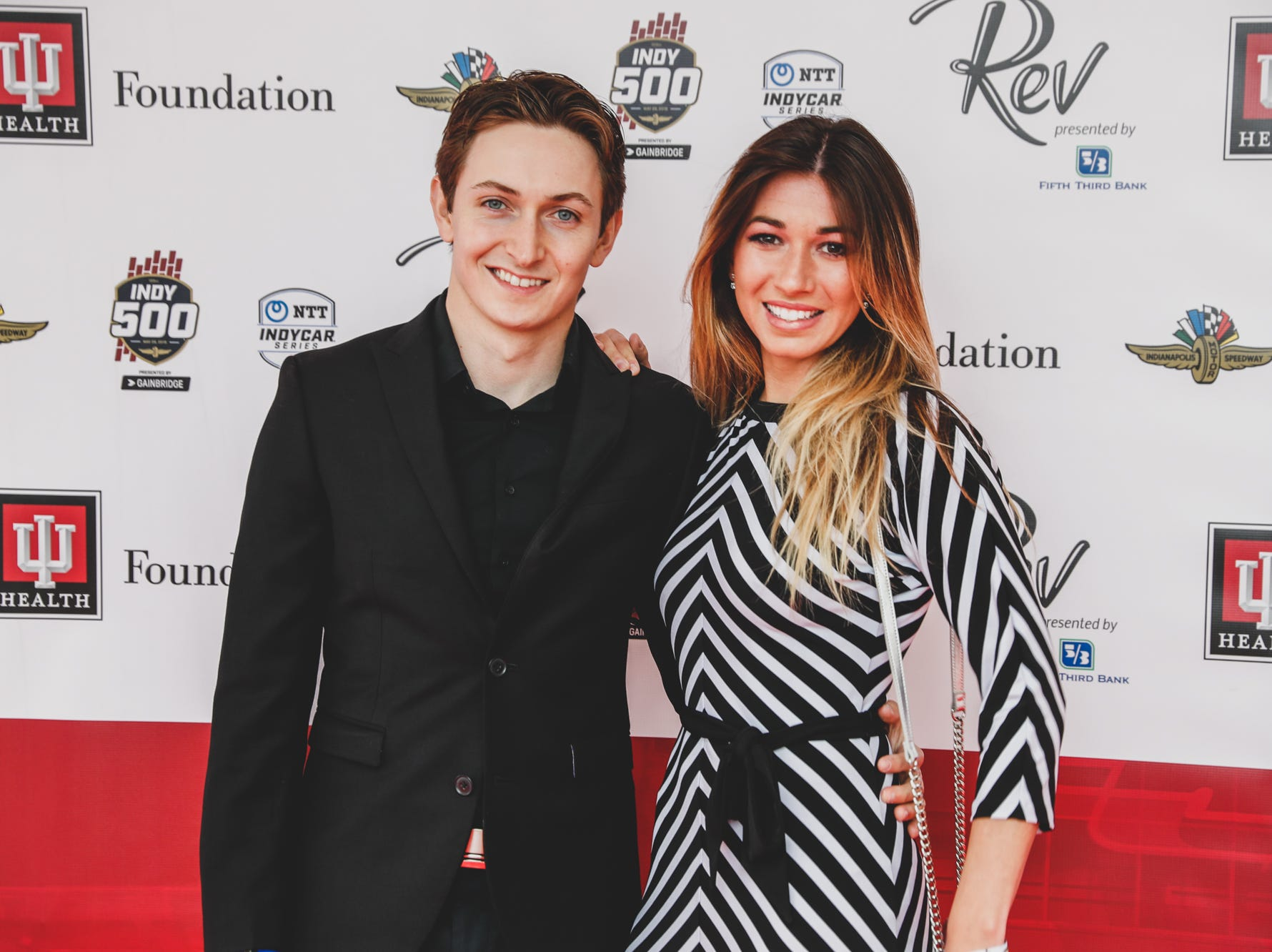 IndyCar driver Zach Veach and Kate McConnell walk the red carpet at the Rev Indy fundraiser, held at the Indianapolis Motor Speedway on Saturday, May 4, 2019. Funds raised support the IU Health Foundation statewide and the IU Health Emergency Medical Center at IMS.