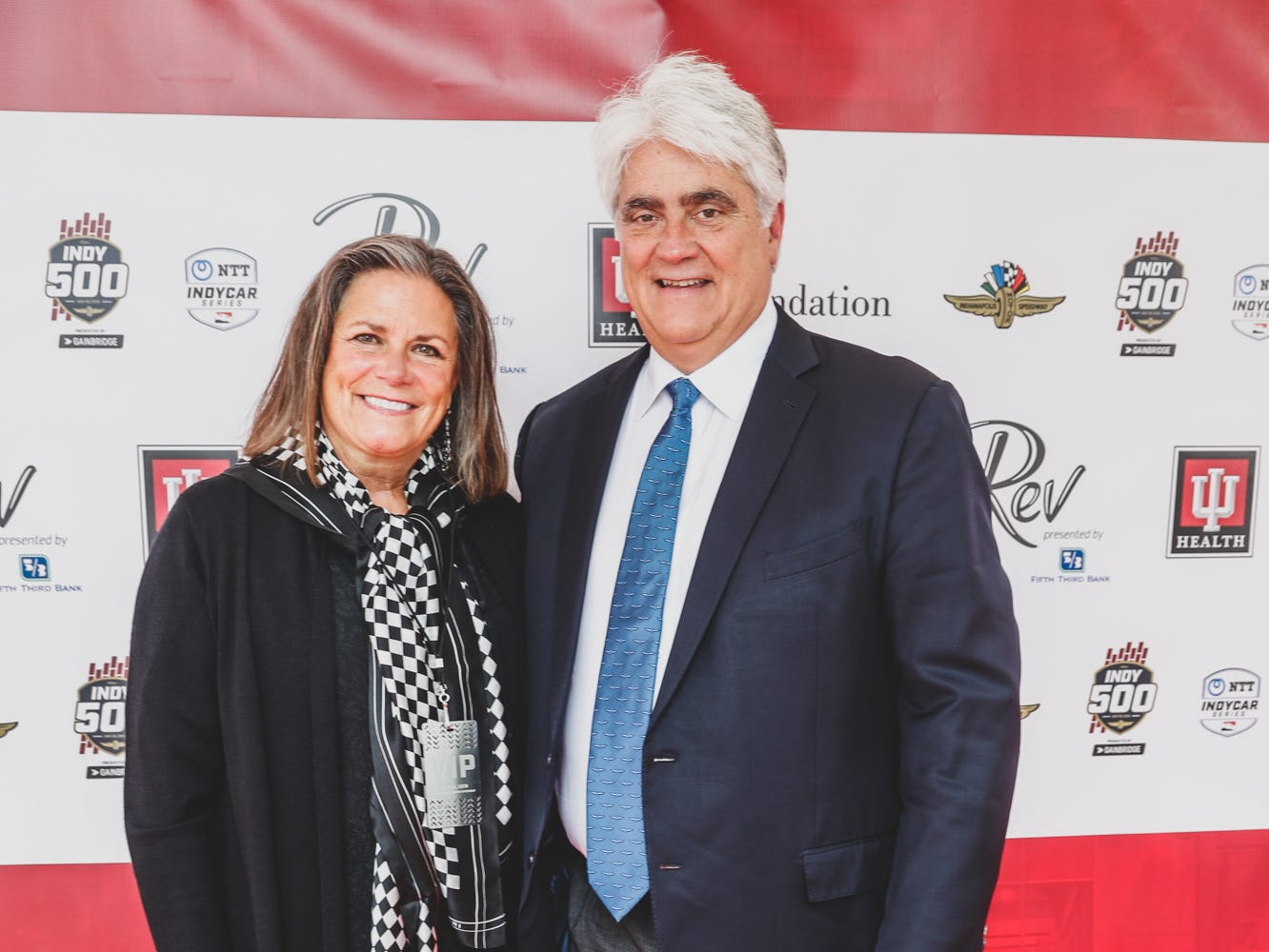 President and Chief Executive Officer of Hulman & Company, Mark Miles and his wife Hellen Miles walk the red carpet at the Rev Indy fundraiser, held at the Indianapolis Motor Speedway on Saturday, May 4, 2019. Funds raised support the IU Health Foundation statewide and the IU Health Emergency Medical Center at IMS.