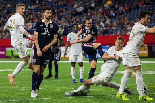 Indy Eleven's Thomas Enevoldsen, in blue, right, takes a shot on the North Carolina goal the team's 0-0 match against North Carolina FC at Lucas Oil Stadium on Saturday.