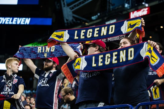 Brickyard Battalion fans hold up scarves in honor of Brad Ring, a former Indy Eleven player during the team's 0-0 match against North Carolina FC at Lucas Oil Stadium on Saturday.