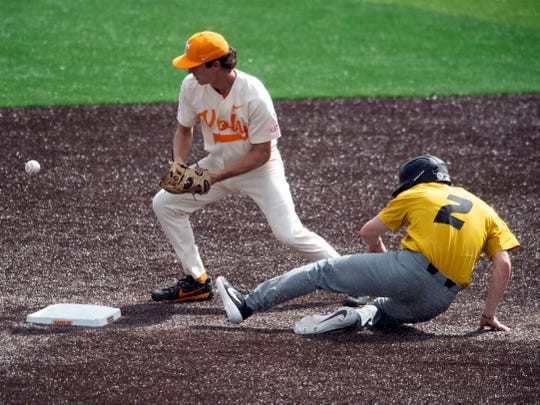 Tennessee's Jake Rucker loses the ball after Missouri's	Thomas Broyles is forced out at second base at Lindsey Nelson Stadium on Sunday, May 5, 2019.