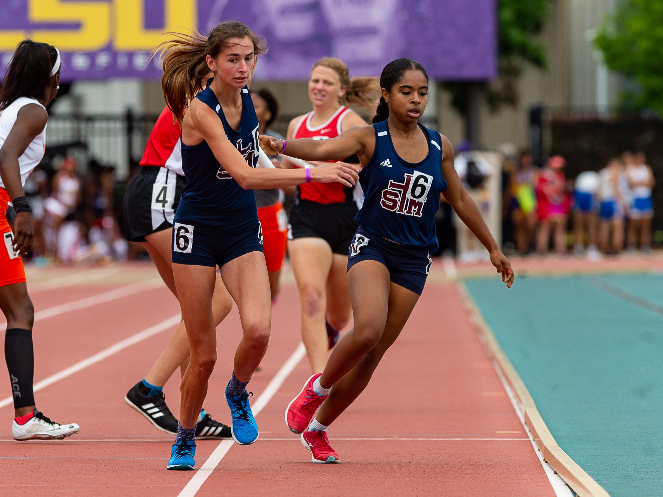 Mia Parker runs the second leg of the girls 4x800 relay at The LHSAA Sate Track Meet at Bernie Moore Track in Baton Rouge, LA. Saturday, May 4, 2019.