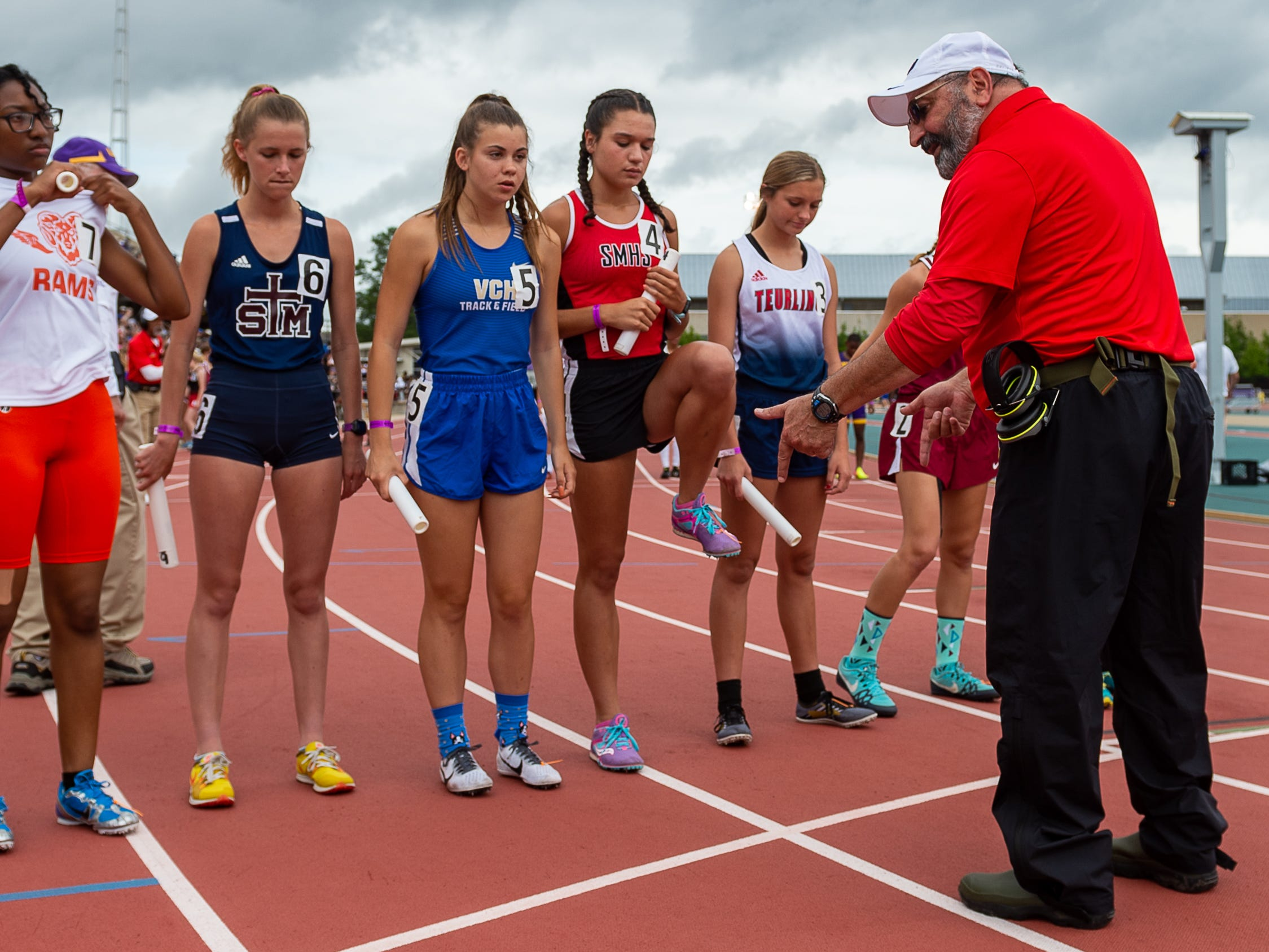 Race Official Doug Saloom gives instruction to runners at The LHSAA Sate Track Meet at Bernie Moore Track in Baton Rouge, LA. Saturday, May 4, 2019.