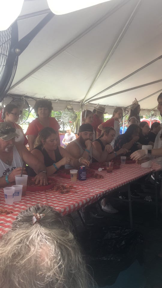 Some of the 16 crawfish eating contestants chow down. The only rules for the 45 minute contest is 'what goes down, stays down'. Seems fair.