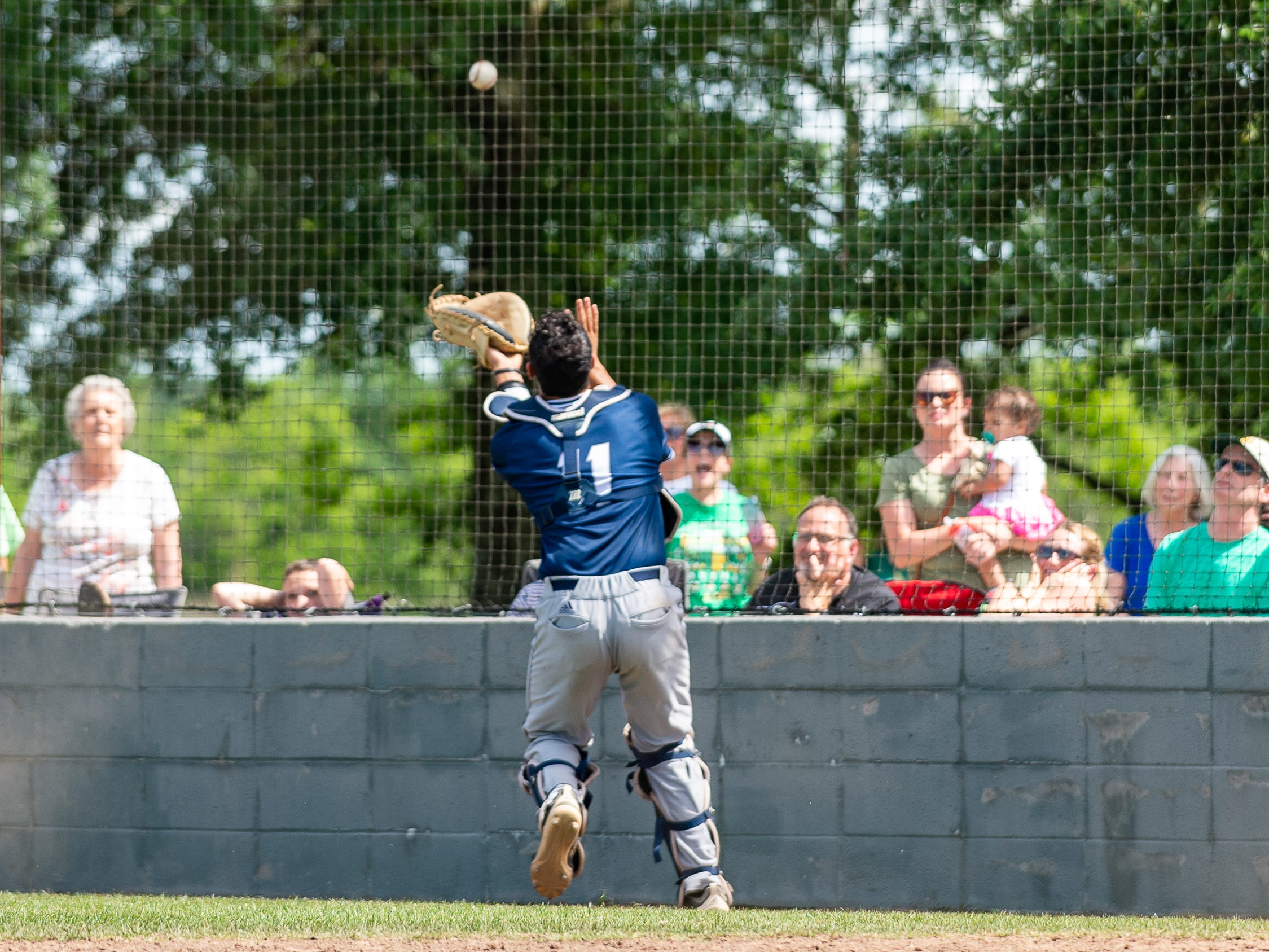 Catcher Austin Arceneaux makes a catch as the Ascension Blue Gators take on Holy Savior Menard in game two of the semi final round of the LHSAA playoffs. Sunday, May 5, 2019.