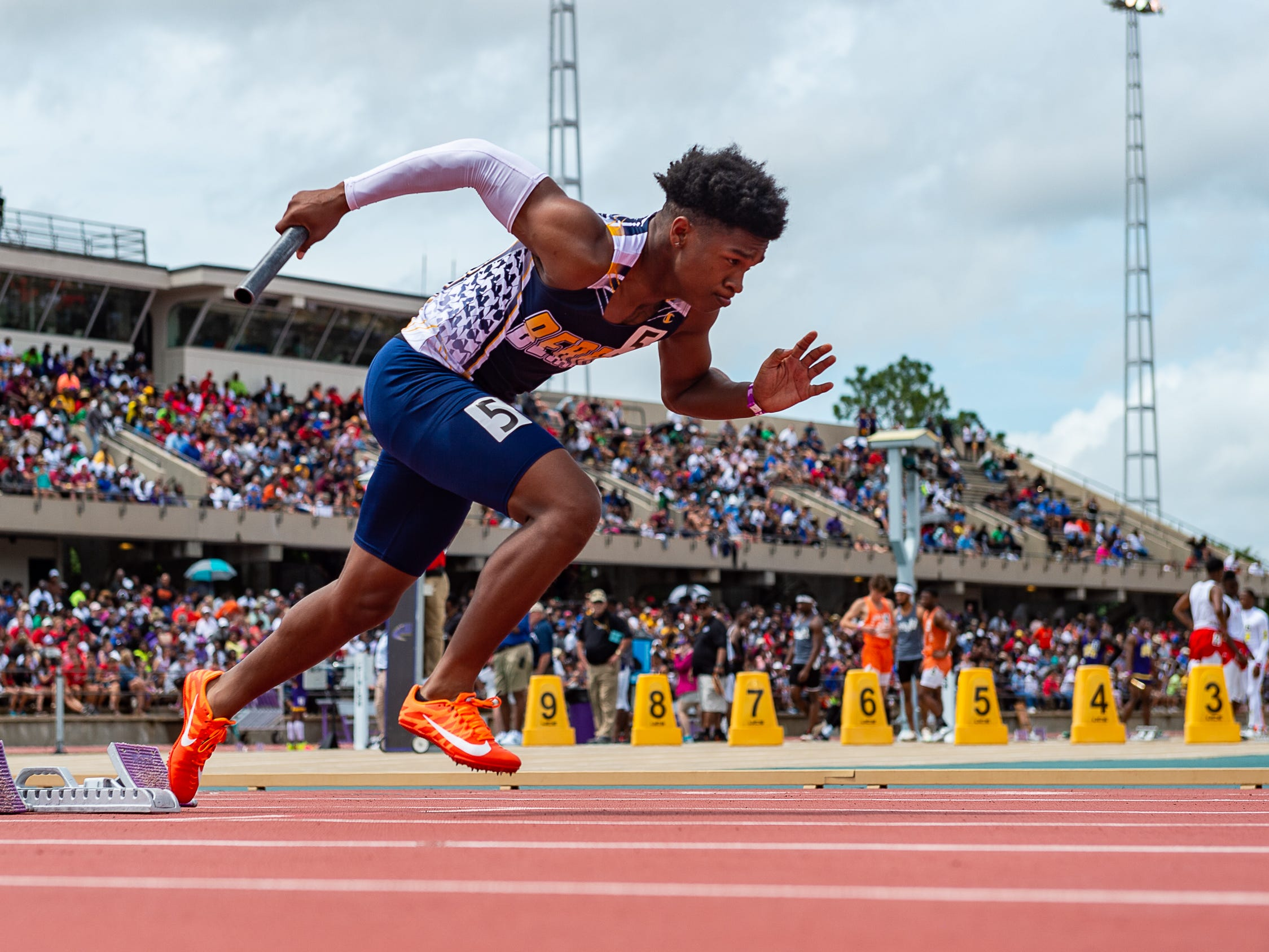 Carencros Artrell Marks leads off the boys 4x200m relay at The LHSAA Sate Track Meet at Bernie Moore Track in Baton Rouge, LA. Saturday, May 4, 2019.