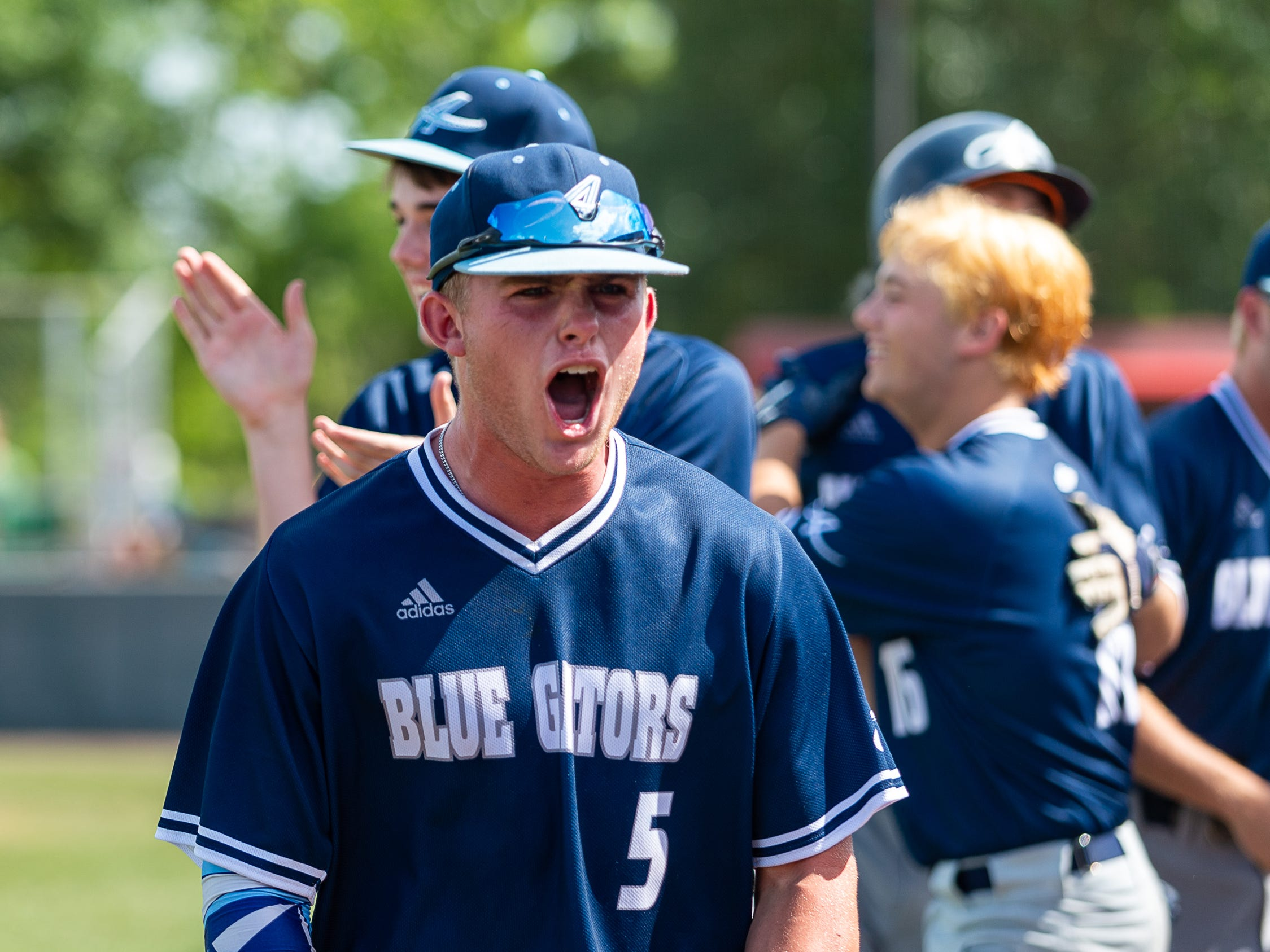 Blaine Blanchard celebrates as the Ascension Blue Gators take on Holy Savior Menard in game two of the semi final round of the LHSAA playoffs. Sunday, May 5, 2019.