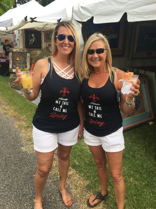 Sassy shirts were a common thing at the Crawfish Festival. Wendy Moss and Tanda Lutz showing how it's done.