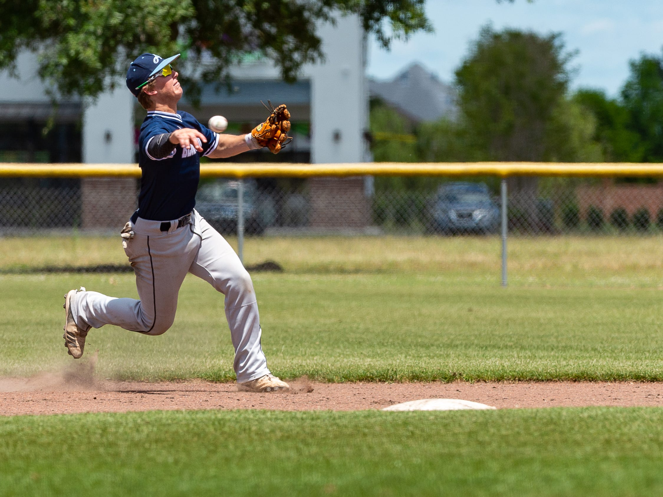 Will Kerstetter throws down to first as the Ascension Blue Gators take on Holy Savior Menard in game two of the semi final round of the LHSAA playoffs. Sunday, May 5, 2019.