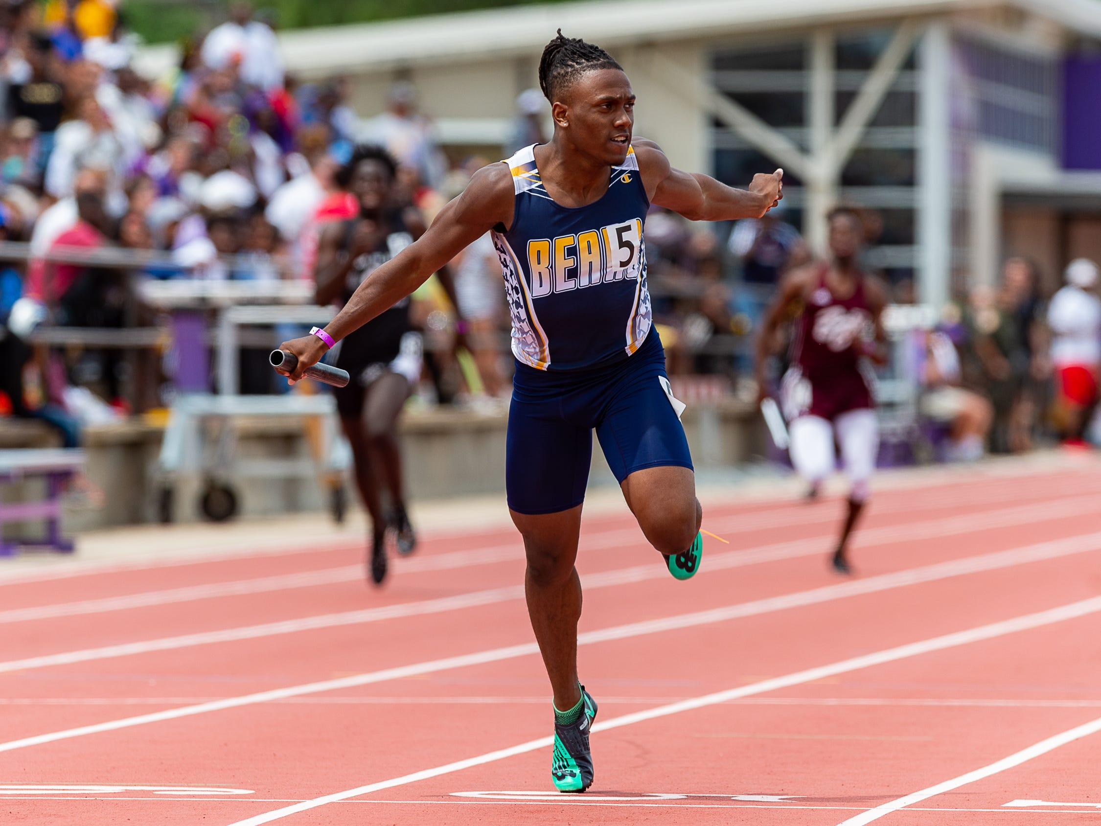Carencro's Trejun Jones wins the boys 4x200 relay at The LHSAA Sate Track Meet at Bernie Moore Track in Baton Rouge, LA. Saturday, May 4, 2019.