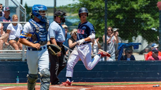 Rebels Ben Tate crosses home plate as Teurlings Catholic takes on St. Charles in game two of the semi final round of the LHSAA playoffs. Sunday, May 5, 2019.