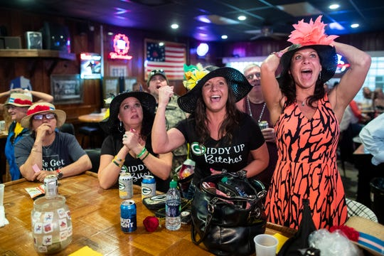 Kat McMillan, from right, Connie Sargent and Melissa Goble react watching the running of the 145th Kentucky Derby at the VFW Post on Longfield Avenue. May 4, 2019