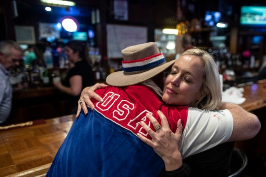 Frank Bibbelhauffen, left, hugs Alissa Hinkle at the VFW Post bar on Longfield Avenue following the 145th Kentucky Derby. May 4, 2019