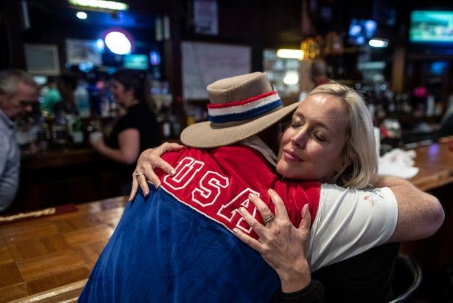 Frank Bibbelhauffen, left, hugs Alissa Hinkle at the VFW Post bar on Longfield Avenue following the 145th Kentucky Derby. May 4, 2019