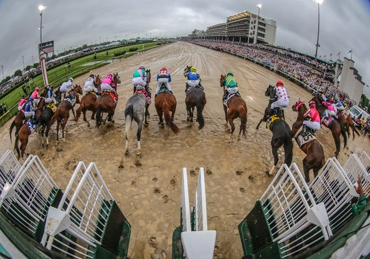 Horses leave the starting gate for the 145th Kentucky Derby.