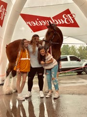 Lexi Clifford, Alyssa Goodlet and Hailey Hubbs meet the Budweiser Clydesdales.  Purofirst Disastor Services Derby Party won a contest sponsored by Budweiser to bring the horses to one lucky local at home party Saturday, May 4, 2019.