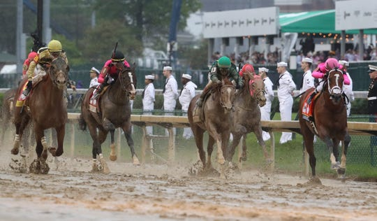 Jockey Luis Saez, far, right, led the pack to finish first aboard Maximum Security in the Kentucky Derby at Churchill Downs, but was later disqualified.  Jockey Flavien Prat, far left, aboard Country House was later declared to be the winner. May 4, 2019