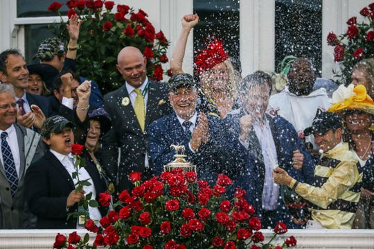 Jockey Flavier Prat sprays champagne to the delight of the owners group after Country House was declared the 145th Kentucky Derby winner.  May 4, 2019