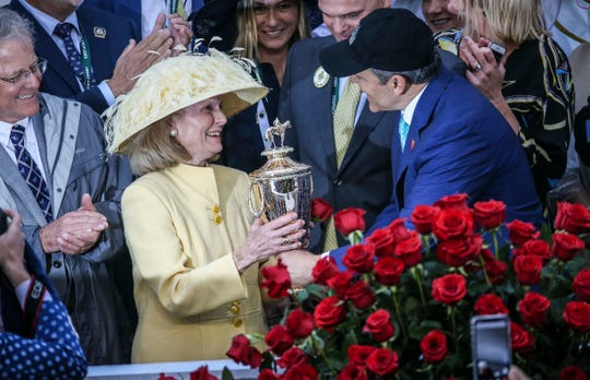Gov. Matt Bevin presents the Kentucky Derby Trophy to Miss Maury Shields, the widow of the late Joseph Shields who bred Country House,  named the winner of the 145th Kentucky Derby Saturday after the disqualification of Maximum Security.  May 4, 2019