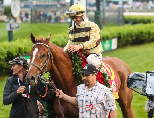 Country House and jockey Flavien Prat celebrate after winning the 2019 Kentucky Derby.