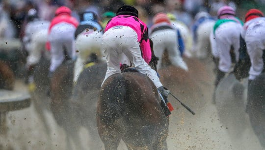 Horses make their way around the first turn in the 145th Kentucky Derby.May 4, 2019