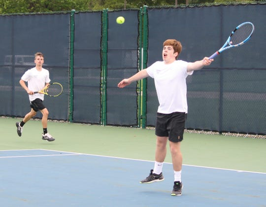 Brent Webster (left) and Ryan Mecurio continued their strong play together by winning No. 1 doubles in Saturday's Ohio Cardinal Conference tennis tournament.