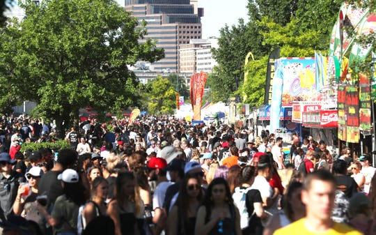 Fans mill around Sunday at the 2019 Beale Street Music Festival, part of the Memphis in May International Festival at Tom Lee Park in Downtown Memphis.
