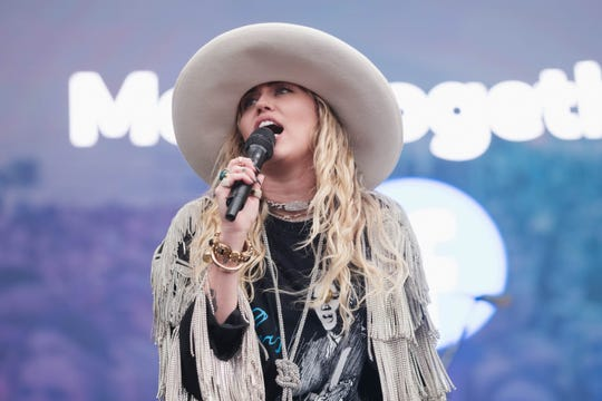 Miley Cyrus performs at Beale Street Music Festival.