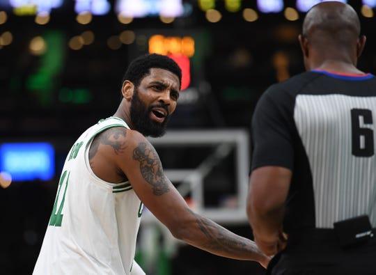 Celtics guard Kyrie Irving complains to referee Tony Brown about a call in the second half and then whined about the amount of free throws the Bucks, and especially Giannis Antetokounmpo, shot in the third quarter of Game 3 on Friday.