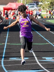 Elijah Johnson left Milwaukee Washington with three state track and field titles.