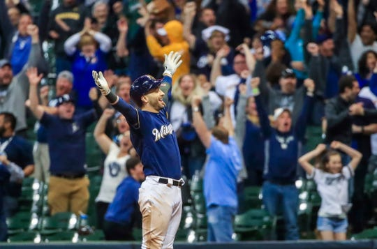 Ryan Braun gets ready to be mobbed by his teammates after he delivered a winning two-run single in the bottom of the 18th inning for the Brewers in their victory over the Mets.