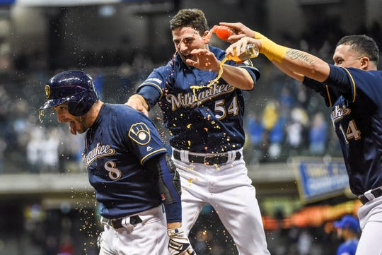 Ryan Braun is doused with Gatorade by Brewers teammates after his game-winning two-run single against the Mets in the bottom of the 18th inning Saturday night at Miller Park.