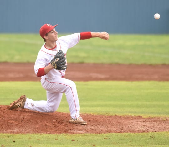 Flippin pitcher Layton Fischer delivers to the plate against Mountainburg on Saturday.