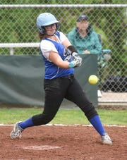 Cotter's Abby Ewing connects with a pitch against Danville on Saturday.