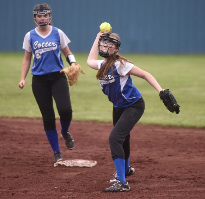 Cotter's Courtney Benedict throws to first for an out against Danville on Saturday.