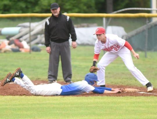 Flippin first baseman Brycen Benedict applies a tag against Mountainburg on Saturday.