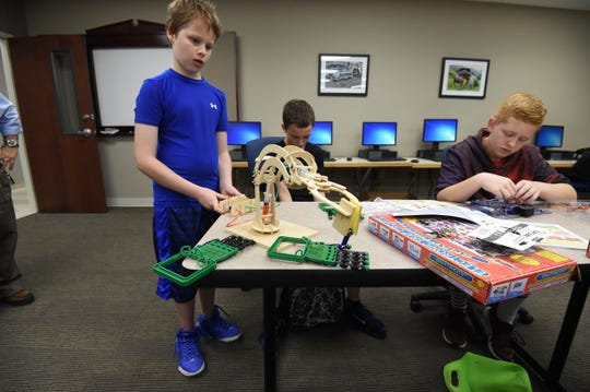 Pinkston Middle School Students (from left) Austin Waggoner, Robert Williams and Lucas Bockstahler work with electronics and robotics items Friday at Arkansas State University-Mountain Home during the STREAM 2.0 event.