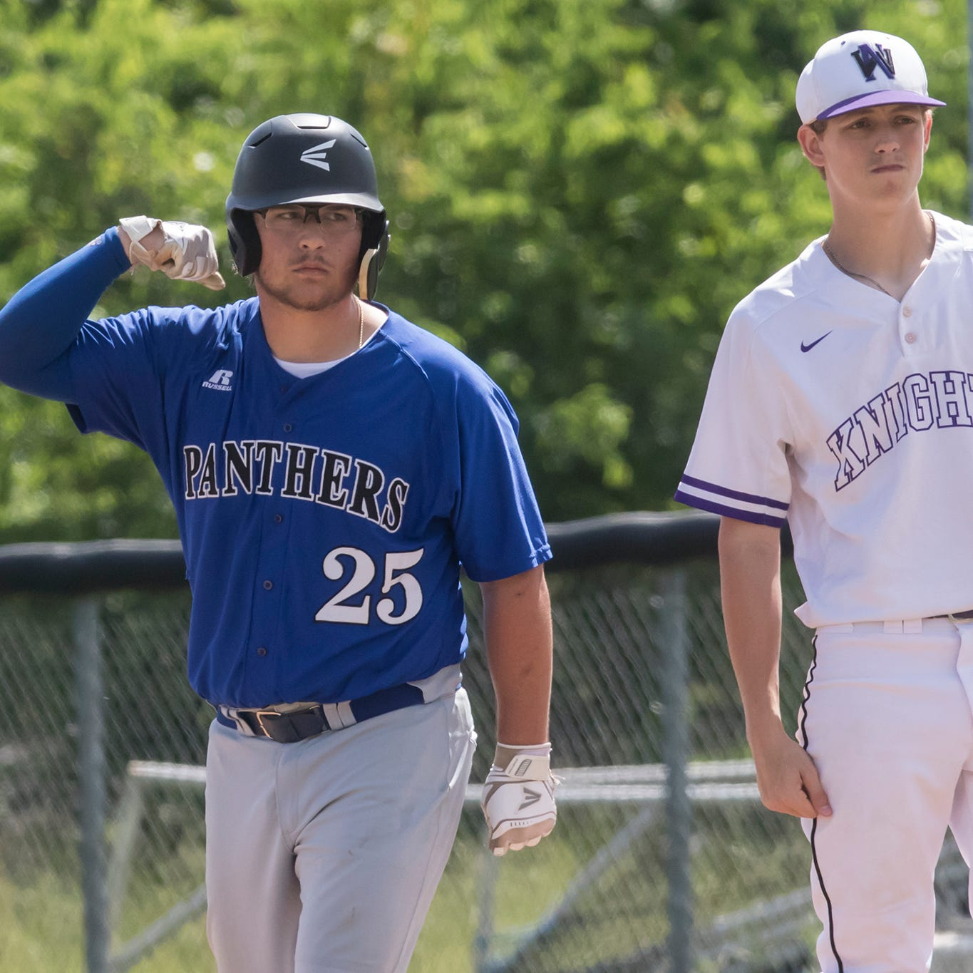 Sterlington's Braden Hough (25) flexes behind North Webster's Gavin Gilleatine (1) after his 2 RBI single in the top of the second inning during the game at Panther Field in Sterlington, La. on May 5.