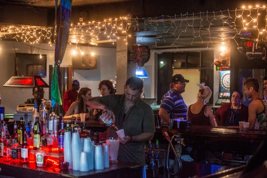 Guests gather around the bar as downtown Montgomery's Club 322 held it's farewell party Saturday, May 4, 2019, which lasted until early Sunday morning.