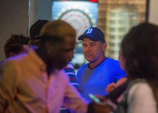 Club 322 owner Jerry Cook, center, talks with guests  during the club's farewell party Saturday, May 4, 2019.