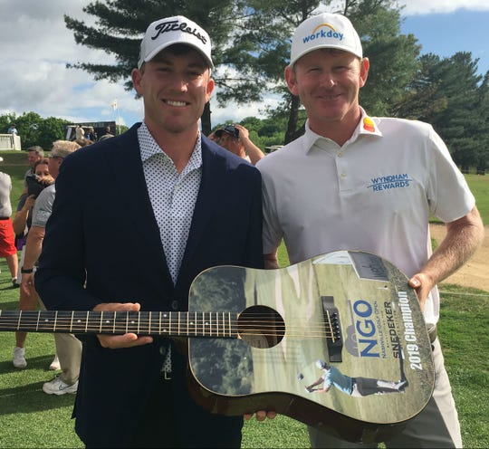 Robby Shelton, left, with Brandt Snedeker shows off his guitar trophy after winning the Nashville Golf Open Benefiting the Snedeker Foundation at Nashville Golf and Athletic Tournament.