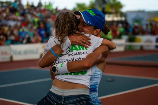 Simone Jardim hugs her daughter Alexa Edwards after her win with teammate Kyle Yates at the Minto U.S. Open Pickleball Championships at East Naples Community Park on May 4, 2019.